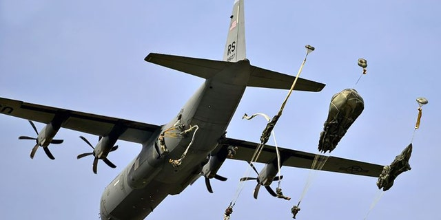U.S. paratroopers conduct an airborne operation from a C-130 Hercules aircraft on Juliet Drop Zone near Pordenone, Italy, Sept. 24, 2014.