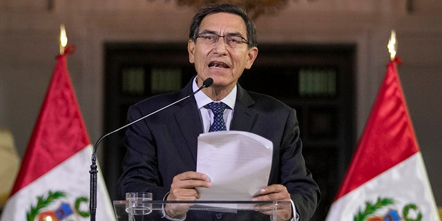 Peru's President Martin Vizcarra delivers a national message from the government palace in Lima, Peru, on Monday.