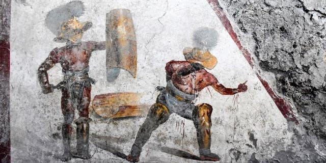 The fresco was found in what scientists trust was a pub busy by gladiators.