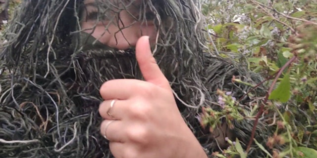 Woman disguises herself as a bush to capture sister's wedding proposal