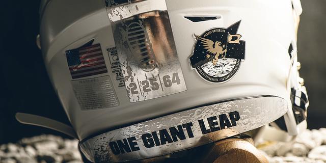 The helmet stripe celebrates Purdue alums' contribution to space exploration.