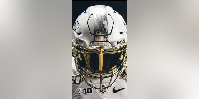 The Boilermakers will take the field wearing white helmets with a chrome gold mask, which is designed to resemble an astronaut's helmet. (Purdue University)