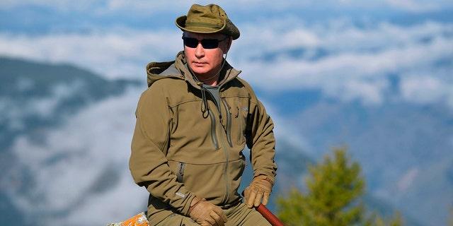 Putin rests on a hill in Siberia during a break from state affairs ahead of his birthday. (Alexei Druzhinin, Sputnik, Kremlin Pool Photo via AP)