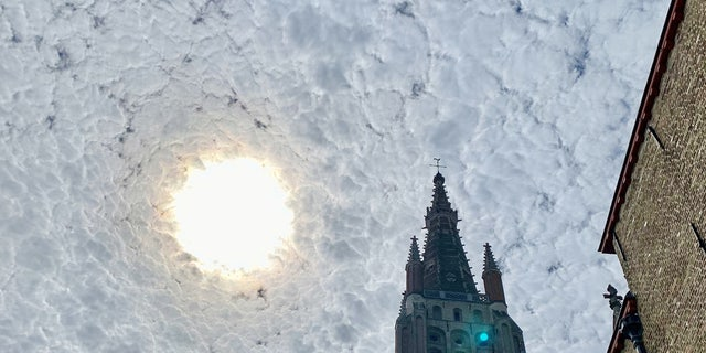 """A tourist made a good impression when he photographed a cloudy sky that looked like it was straight from a Vincent van Gogh painting.The scene looked just like Van Gogh's 19th-century masterpiece """"The Starry Night,"""" so he took a snap."""