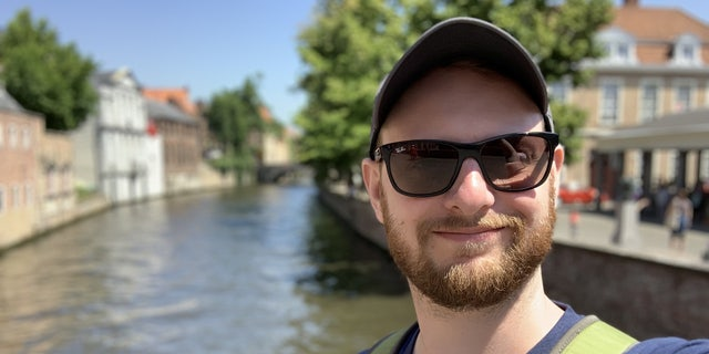 Doron Berlin, 31, was on holiday in Belgium when he looking up to see swirling clouds of blue and grey set against the brilliant sun and spires near Bruges' Belfry bell tower.
