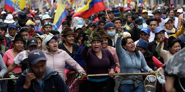 Defiant protesters in Ecuador parade captive police officers