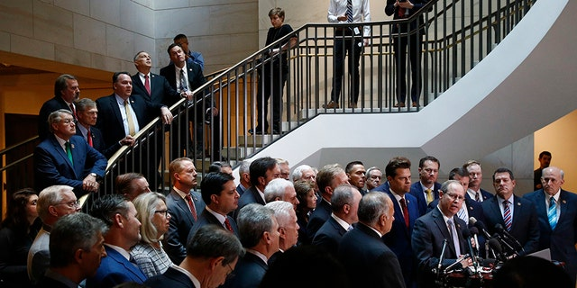 House Republicans hold a news conference before heading into a closed-door meeting where Deputy Assistant Secretary of Defense Laura Cooper was set to testify as part of the House impeachment inquiry into President Trump, on Oct. 23, 2019. (AP Photo/Patrick Semansky)