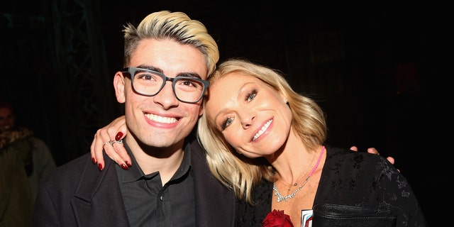 Michael Consuelos and Kelly Ripa pose backstage as Jake Shears of the rock group 'The Scissor Sisters' makes his Broadway debut in the hit musical 'Kinky Boots' on Broadway at The Al Hirschfeld Theatre on January 8, 2018 in New York City.