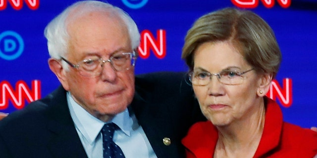In this July 30, 2019 file photo, Sen. Bernie Sanders, I-Vt., and Sen. Elizabeth Warren, D-Mass., embrace after the first of two Democratic presidential primary debates hosted by CNN in the Fox Theatre in Detroit. (AP Photo/Paul Sancya)