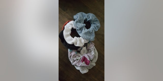 """Apparently it's cool to give your scrunchie to someone you think is cute, below is a stash that we have racked up just this week. So basically stop wasting your money and clogging up my dryer,"" the funny mom said."