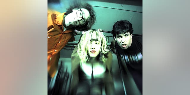 The Muffs (L - R) bassist Ronnie Barnett, lead vocalist Kim Shattuck and drummer Roy McDonald pose for an April 1995 portrait in New York City, New York. (Photo by Bob Berg/Getty Images)