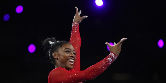 Gold medalist Simone Biles of a United States performs on a safe in a women's apparatus finals during a Gymnastics World Championships in Stuttgart, Germany, Saturday, Oct. 12, 2019. (AP Photo/Matthias Schrader)