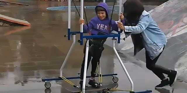 His mom helped push him around the park and up and down the ramps.