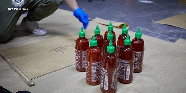 "A 45-year-old man was arrested Thursday morning just outside a home in Edensor Park after task force agents with the NSW Police Force linked him to three other suspects arrested earlier this month in connection with a cargo shipment filled with 768 bottles of sriracha that contained ""ice."""