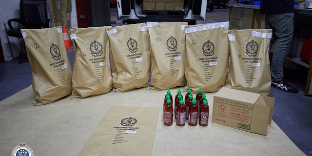 Police found eight more boxes of sriracha in the car and 26 more boxes inside the hotel.