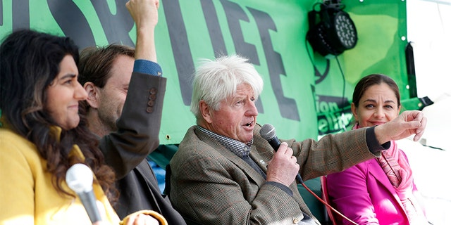 Stanley Johnson, second right, father of the British Prime Minister Boris Johnson, speaks at an Extinction Rebellion panel on climate change in Trafalgar Square, on the third day of ongoing demonstrations in London, on Wednesday.