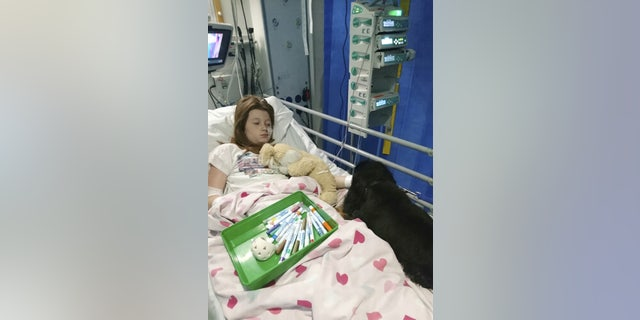 Gracie Whittick in hospital following the stroke.