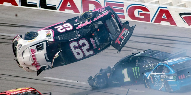 Brendan Gaughan (62) got flipped during a multi-car accident with six laps to go.