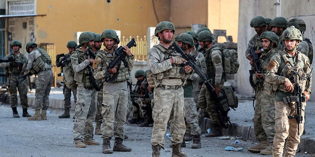 Turkish soldiers secure the Syrian town of Ras al Ayn, in northeastern Syria on Wednesday. (AP/DHA)