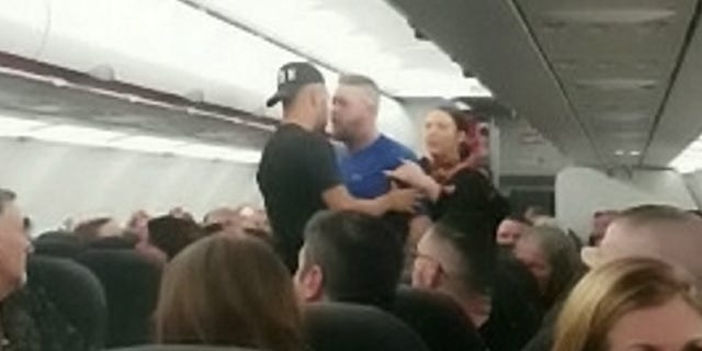 The fight originally broke out at the rear of the plane before the men were separated. A witness says they resumed fighting after a little while, prompting the pilot to make an unscheduled stop in Portugal.