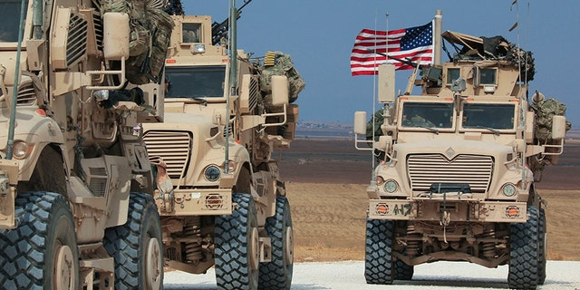 An American military convoy stops near the town of Tel Tamr, north Syria, on Sunday.