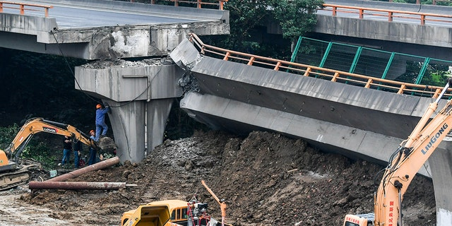 Rescuers work at the site of an overpass collapse in the city of Wuxi, east China's Jiangsu Province, on Friday.