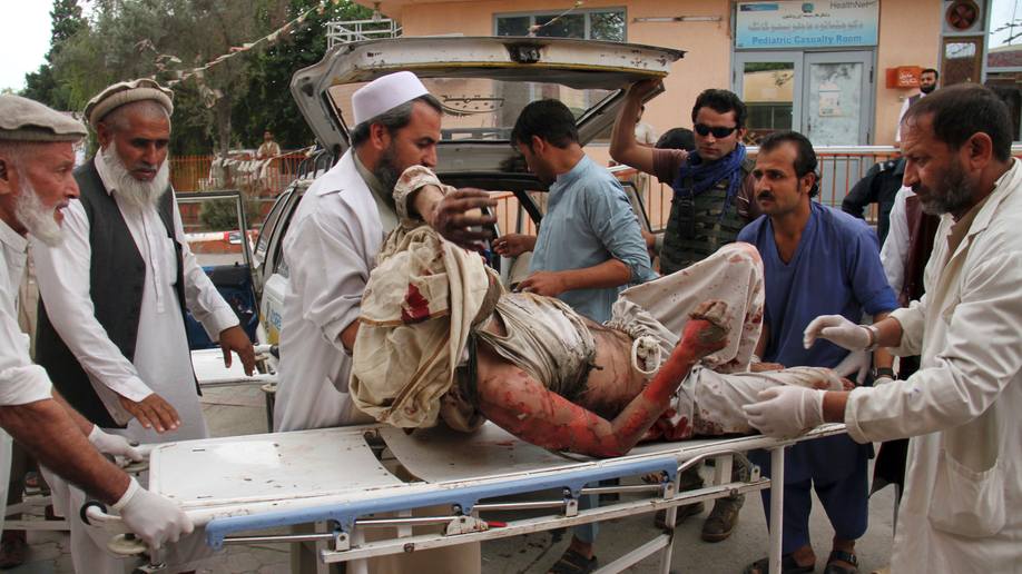 Blasts in Afghanistan mosque kill at least 62, wound more than 100