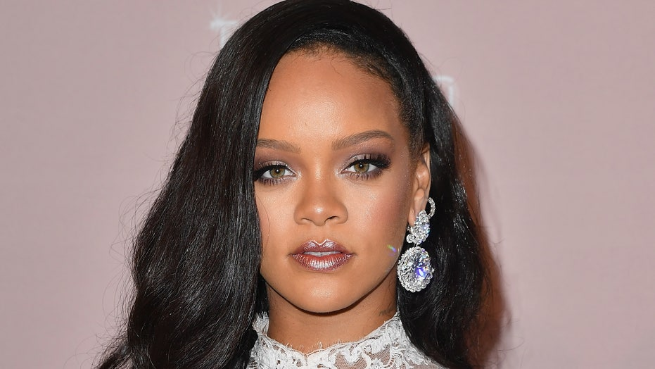 Rihanna celebrates Biden's inauguration by taking out the trash