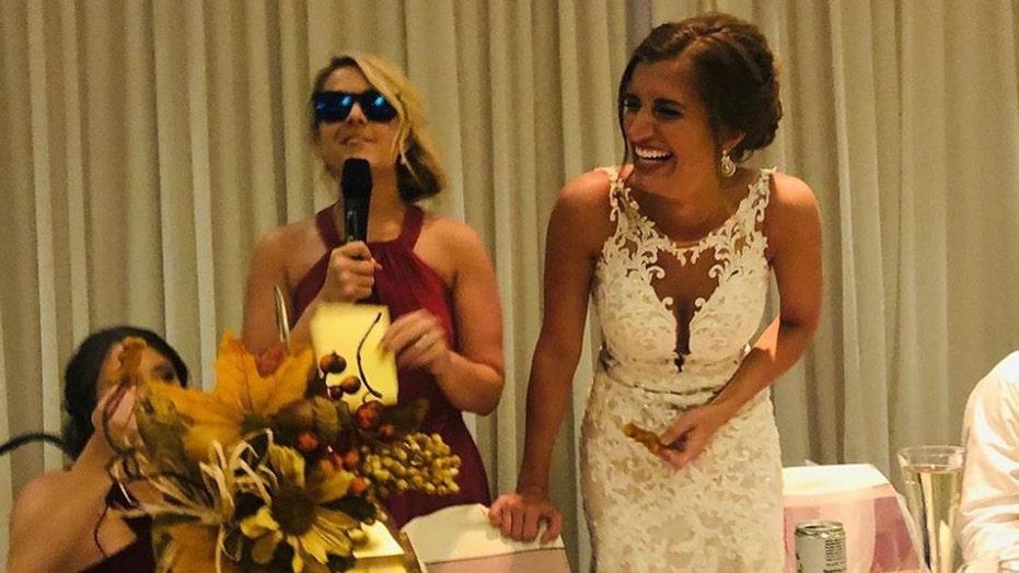 Watch: Wedding guest flees reception after girlfriend catches bride's bouquet