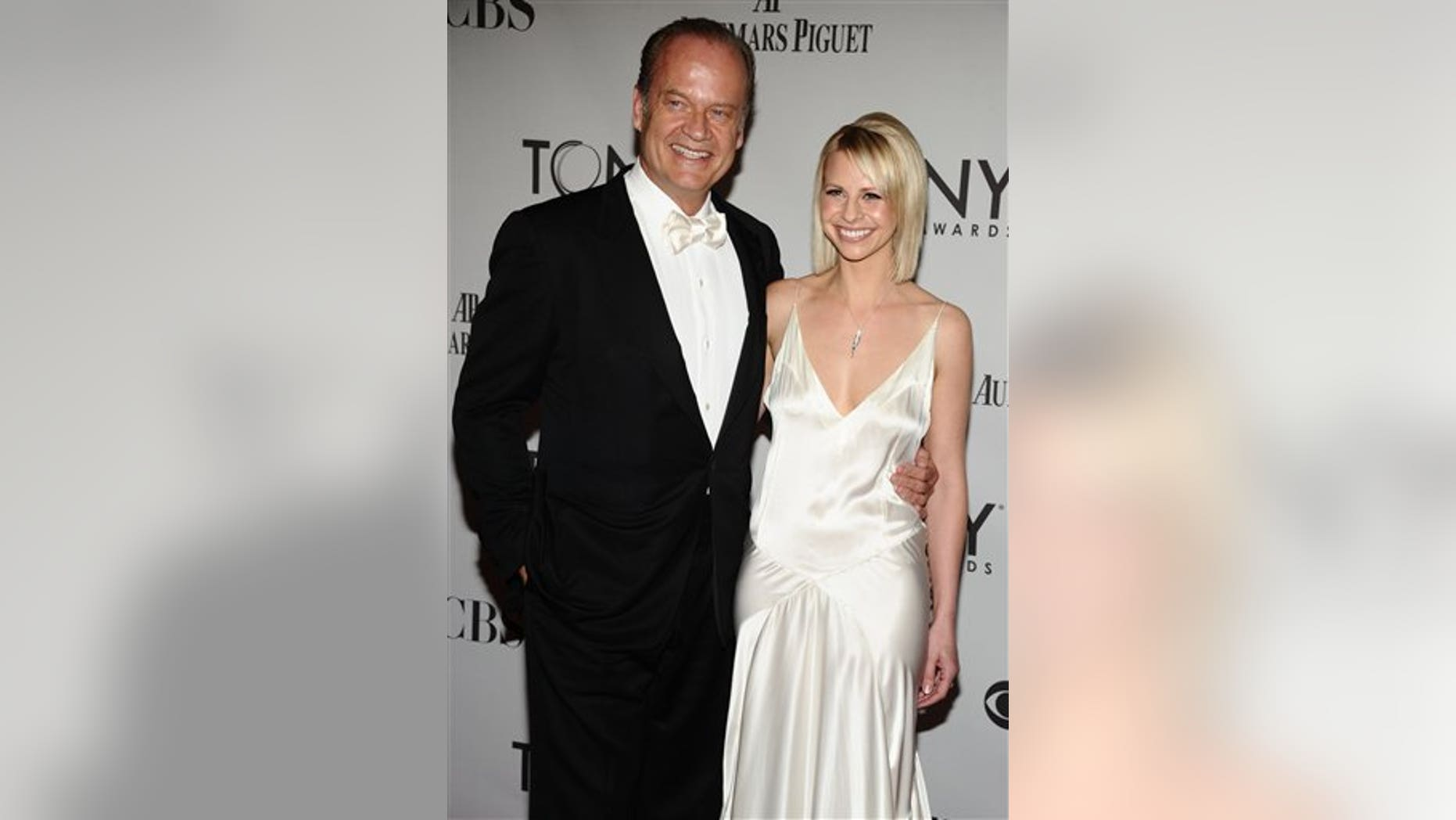 Kelsey Grammer, left, and Kayte Walsh arrive at the 65th Tony Awards, Sunday, June 12, 2011 in New York. (AP Photo/Charles Sykes)