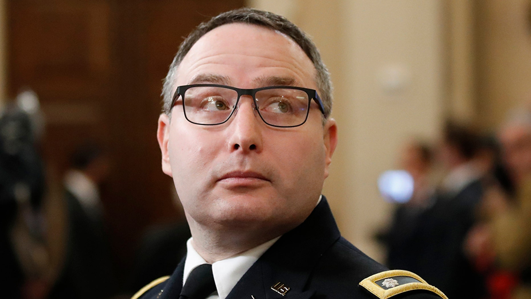 Then-National Security Council aide Lt. Col. Alexander Vindman arrives to testify before the House Intelligence Committee on Capitol Hill in Washington, Tuesday, Nov. 19, 2019, during a public impeachment hearing of President Donald Trump's efforts to tie U.S. aid for Ukraine to investigations of his political opponents. (AP Photo/Alex Brandon)