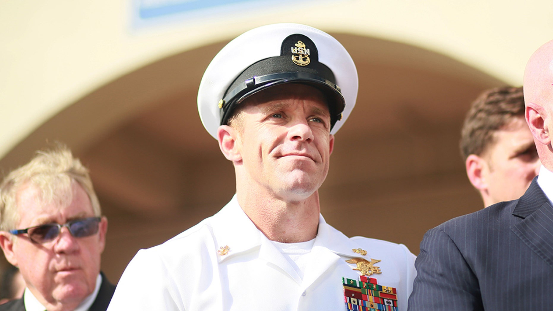 Navy Special Operations Chief Edward Gallagher celebrates after being acquitted of premeditated murder at Naval Base San Diego, Calif., on July 2, 2019. (Photo by Sandy Huffaker/Getty Images)