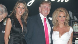Pamela Anderson poses with Melania, Donald Trump in throwback photo