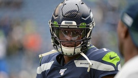 Seattle Seahawks' Geno Smith in middle of social media's coin-flip flap