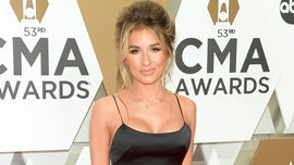 Jessie James Decker wows in satin black dress at 2019 CMAs with husband Eric Decker