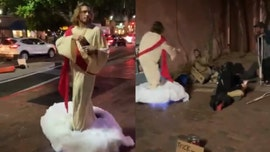 Man wears Jesus costume, hands out bread to homeless man