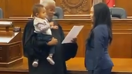 Video of judge holding baby during mom's swearing-in as lawyer goes viral