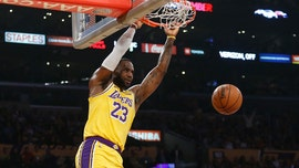 LeBron sets triple-double mark, Lakers hold off OKC 112-107