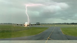 Lightning strikes near Emirates plane at New Zealand airport, 'epic' photo shows