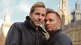 Daughter of Britain's 'first gay dads' approves of father dating her ex-boyfriend
