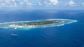 US Navy warships sail through South China Sea, defying China, officials say