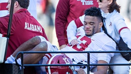 Alabama's Tua Tagovailoa carted off field 'screaming in pain'