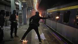 Hong Kong violence forces students to flee, city 'slipping into the abyss of terrorism,' Chinese officials say