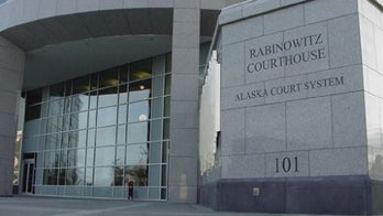 Alaska woman accused of stealing her gun during trial on firearm charges