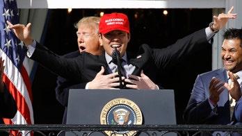 Trump hugs Washington Nationals' Kurt Suzuki, wearing 'MAGA' hat during White House visit