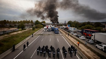 Catalan protesters storm Spain highway, snarling traffic and burning barricades