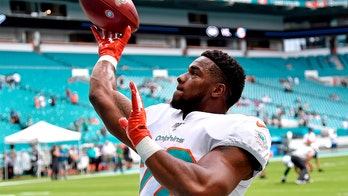 NFL running back Mark Walton's girlfriend heard in 911 call crying, 'My boyfriend beat me up!'