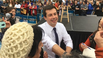 Buttigieg has target on back in Democratic debate, as he rises in polls