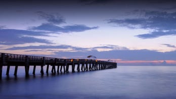 Virginia fishing pier collapses after loose barge strikes it
