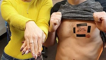 Man proposes with 'Will you marry me?' chest tattoo